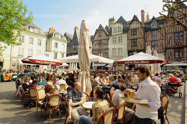 View of the 'Place Plumereau', located in the old city of Tours, with its café terrasse and famous half-timbered houses. The french city of Tours is located on the lower reaches of the river Loire, between Orléans and Saumur. It has a central location in the Loire Valley for anyone eager to discover the World Heritage site composed by Chateaux de la Loire and the Loire river.