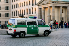 stock-photo-57620416-german-police-van-patroling-berlin-at-sunset